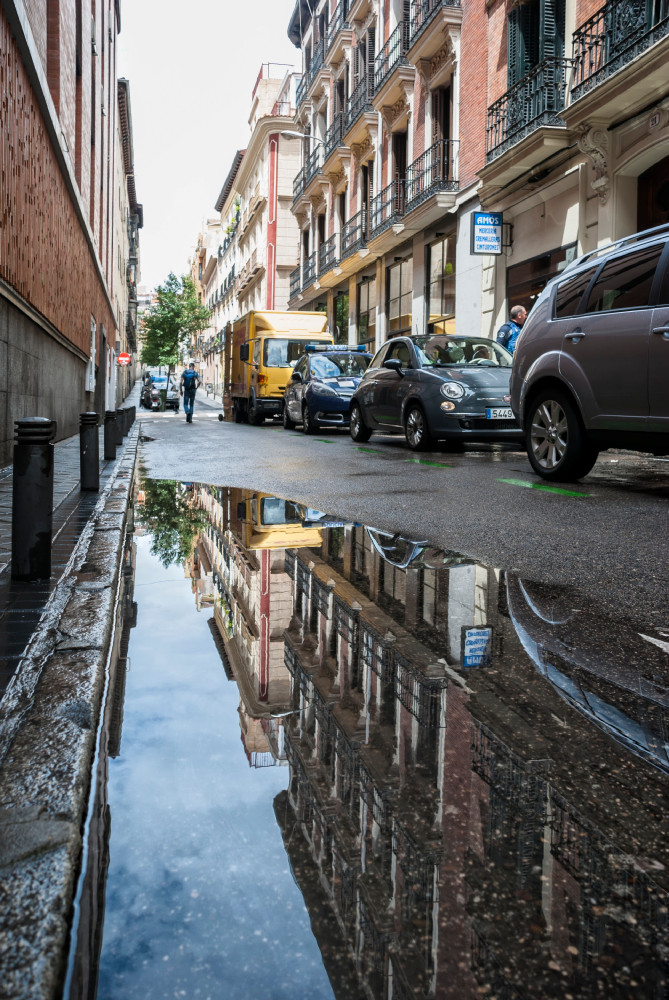 Reflection in the puddle, urban photography in Madrid, Spain, photography tips and tricks
