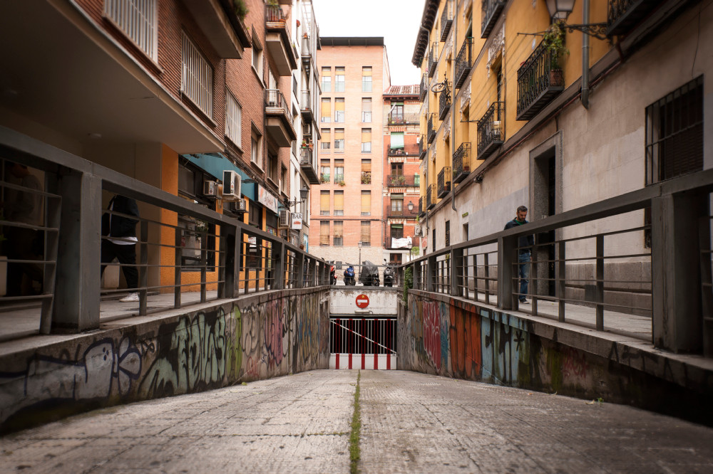 entrance to an underground car park with street art in Madrid Spain