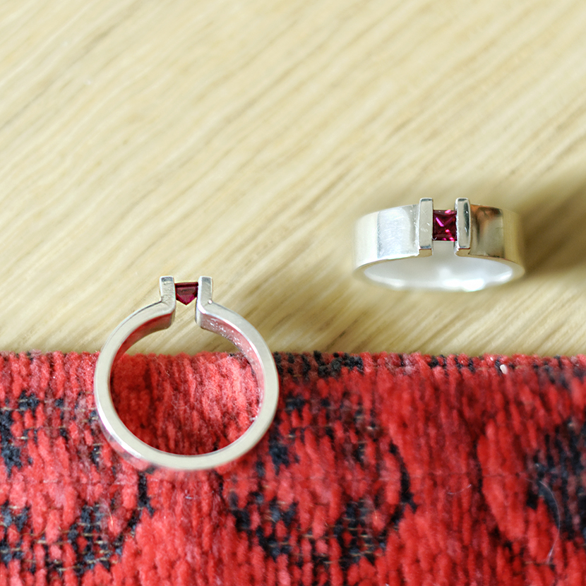 Silver ring with princess cut ruby