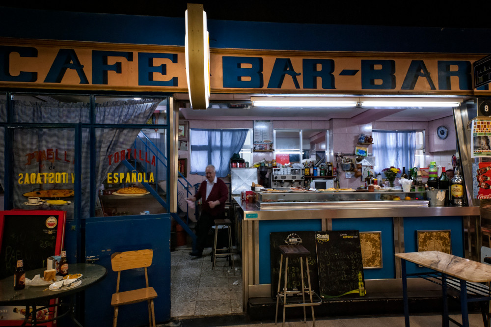 café-bar in a local indoor market in Madrid, Spain