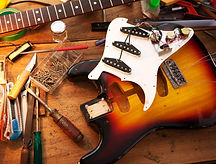 Sunburst electric guitar on guitar repai