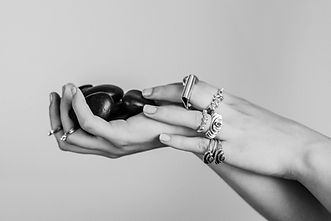 Hand with sterling silver rings - Photo by Caroline Perron