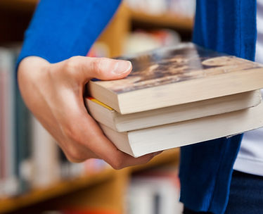 Person in Library holding books