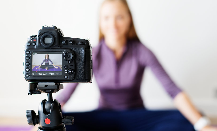Female vlogger recording sports related