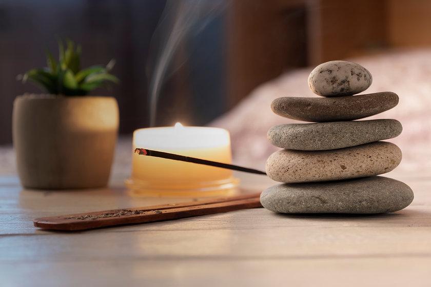 Pyramid of zen stones, burning candle, i
