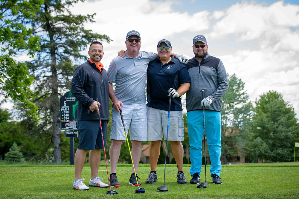 Scherrer Cares Buddy Bench Board Member Mike Reisel (left) and Two Men and a Truck of Milwaukee Owner and Main Sponsor Chris Dahlke (third from left) pose with the rest of their foursome during the tournament.