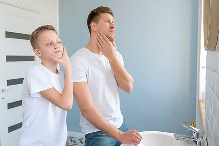 side-view-father-and-son-looking-in-the-
