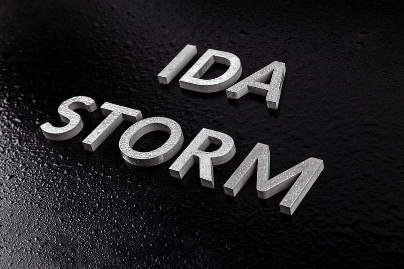 the words ida storm laid with silver metal letters over black surface both covered with ra