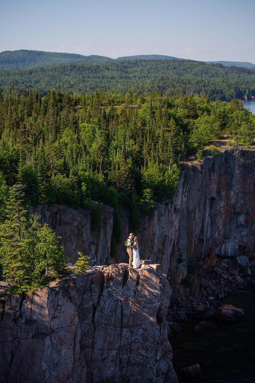 CCBoyle Photography. Couple on the edge of Palisade Head saying I do near Lake Superior.