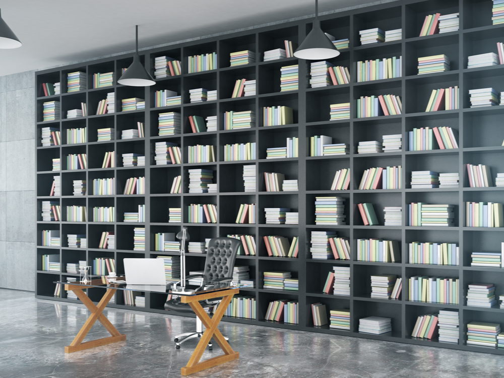 Loft private office with big bookcase, glassy table, and concrete floor, 3D render