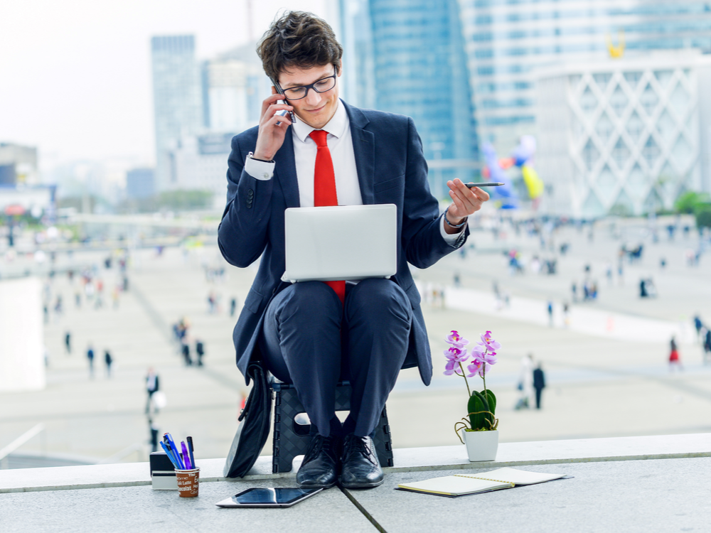Junior executive dynamic leader phoning outside of his office | Virtual Office