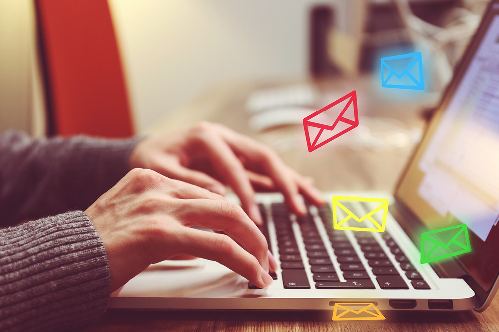 Hands typing on a laptop | Email Management