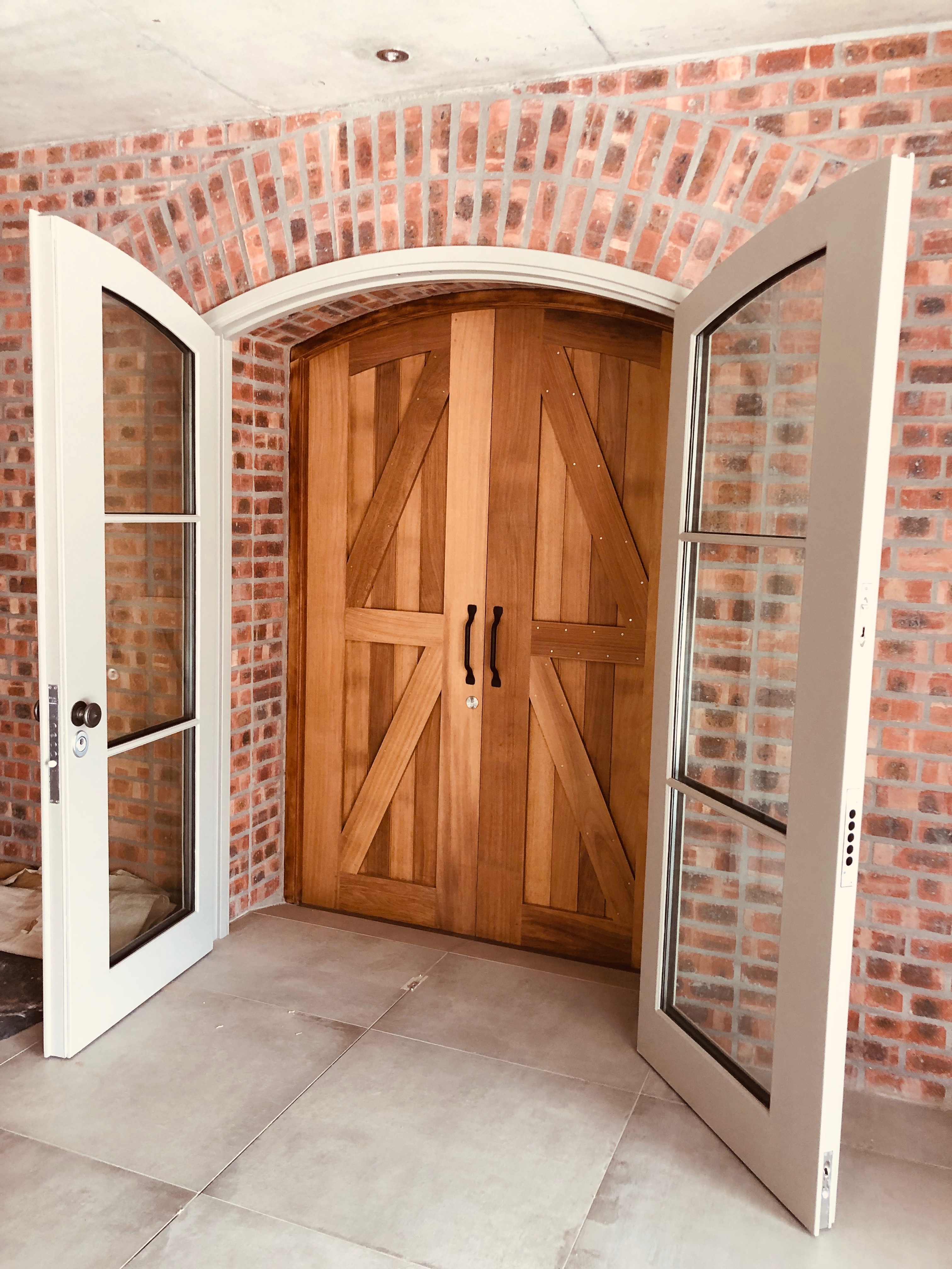 Double armored arch door