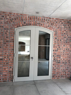 Double armored arch door