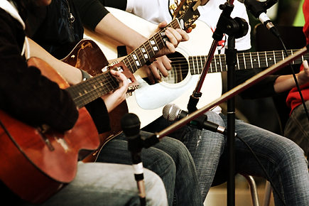 People playing guitars.