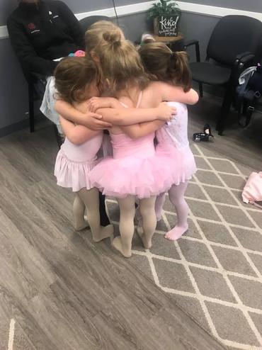 TNJ dancers hugging in the studio
