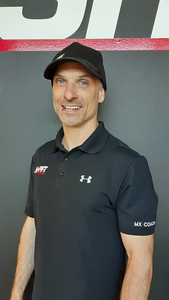 Perth personal trainer, Craig Pangallo, smiling with hat on.