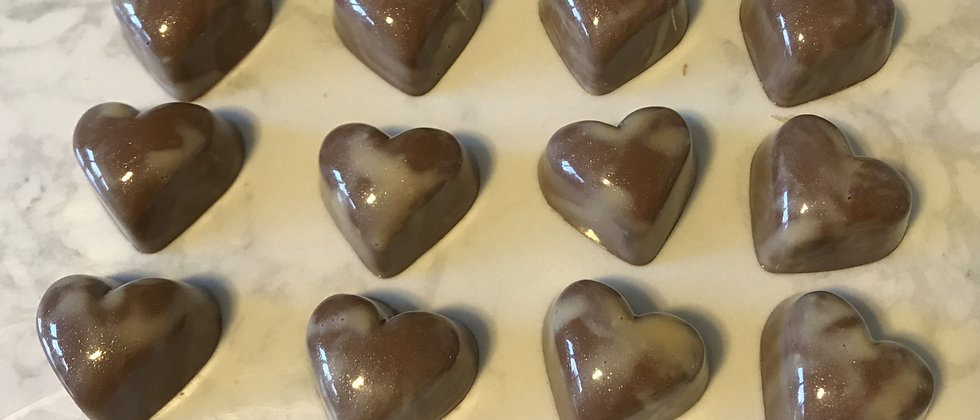 Milk chocolate hearts filled with Marc de Champagne and white chocolate Brazilian truffle