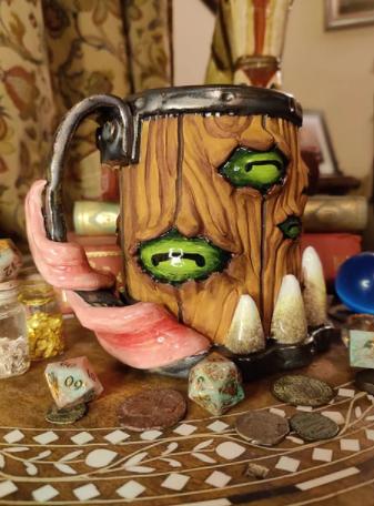 Goat, the multi-eyed mimic | Green-eyed mimic mug from The Monster Inn