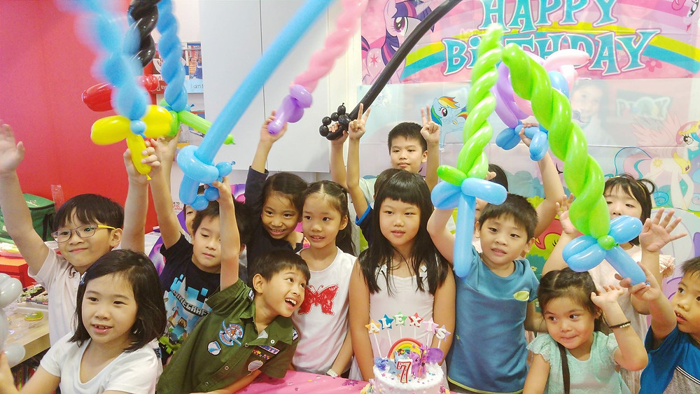 Kids with balloons and happy