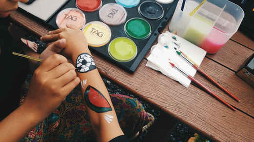 Arm painting for soccer carnival