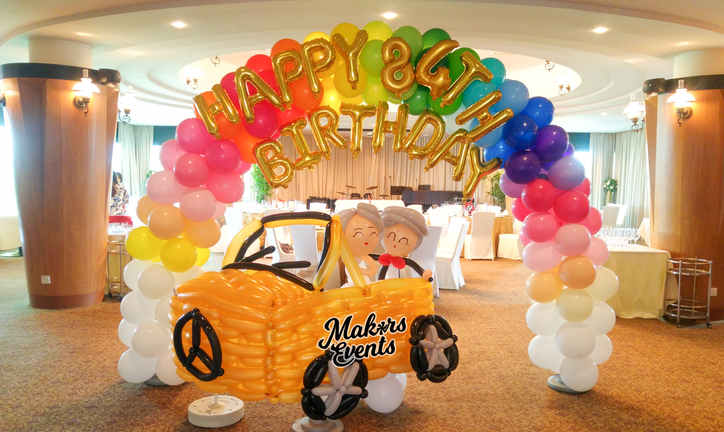 Balloon car decoration Life size. And a rainbow balloon arch! Notice the elderly couple inside the Mercedes vehicle!