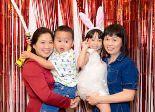 Photo booth with red foil backdrop