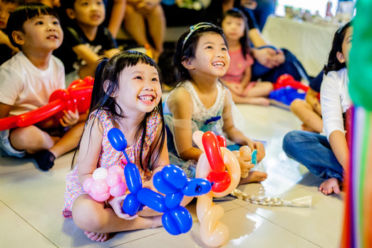 Kids Party Magic Show enaging happy Children at Birthday Party