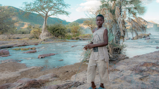 A boy with a toy at Epupa Falls