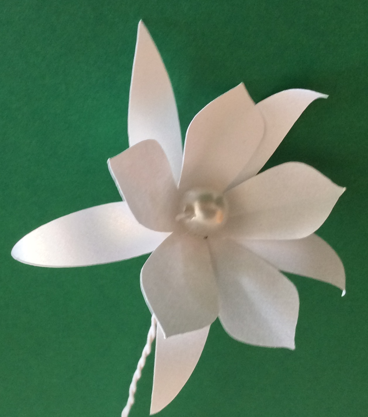 Flor com pérola