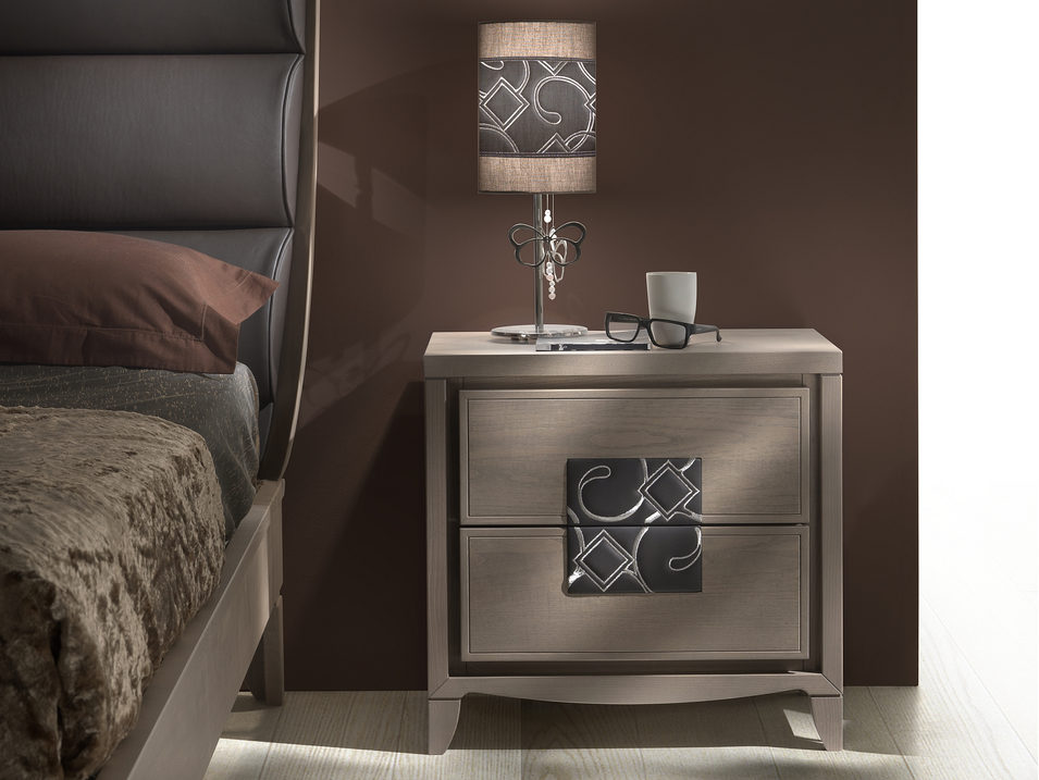 Bedside table with leather insert and embroidered decoration