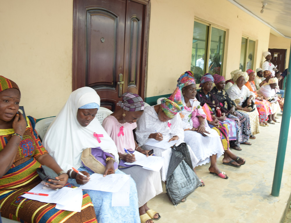 Beneficiaries completing their registration forms