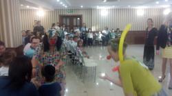 refugees enjoying a clown show