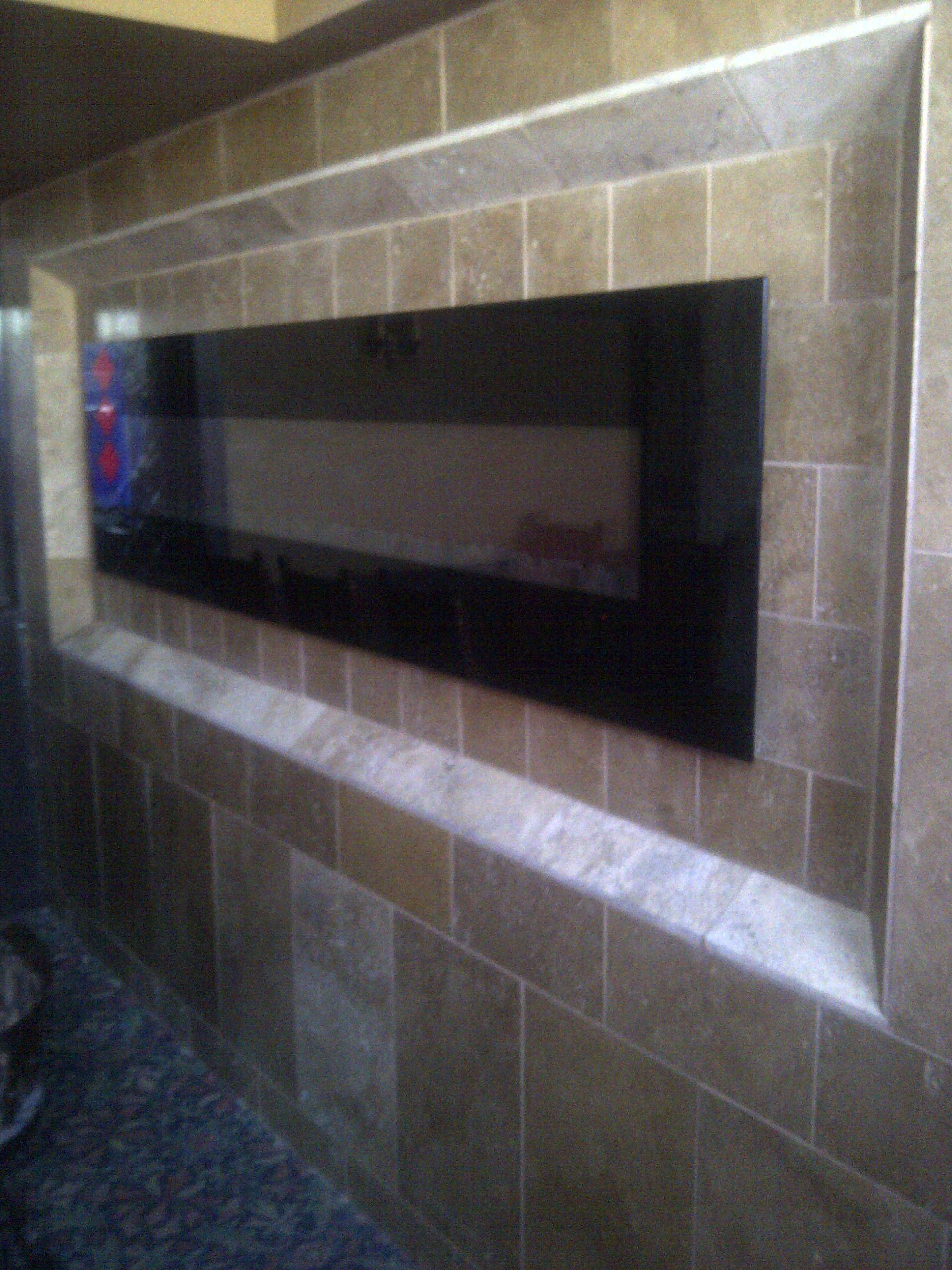 Tiled feature wall with fireplace