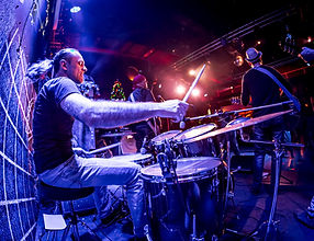 drummer-playing-on-drum-set-on-stage-HDX