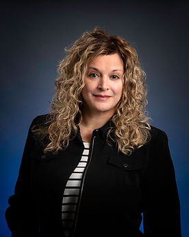 Professional image, business headshot of an attractive woman in a black jacket.