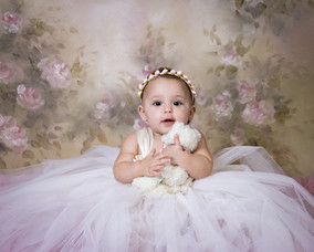 Sitting baby portraits by Crossroads Photography