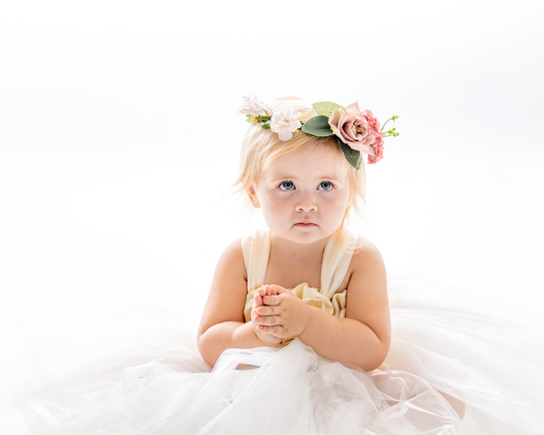 18 month old girl, in a white dress