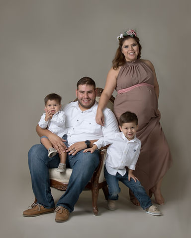 Pregnant Mom with her family portraits by Crossroads Photography, Granbury