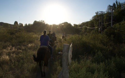 A sunset horse ride right outside the city provides a great view from the mountains.