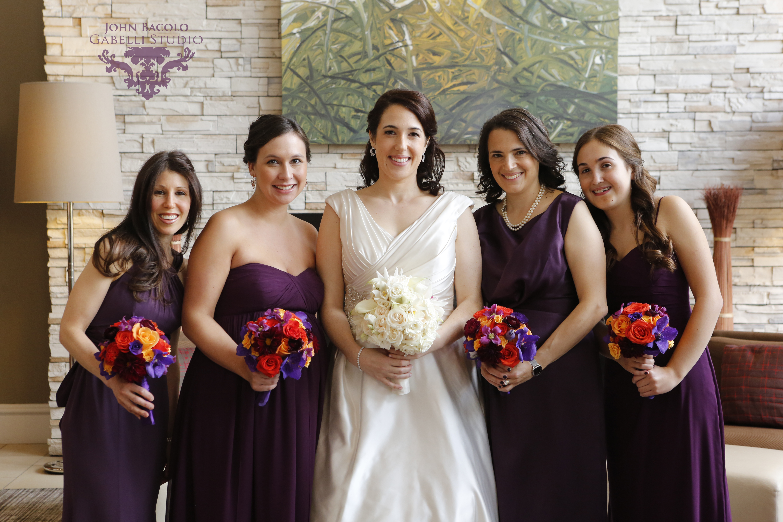 Purple & orange bridesmaids bouquets