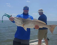 steve gordan with a great redfish.jpg