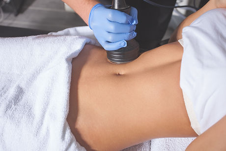 woman body treatment at medical spa cent