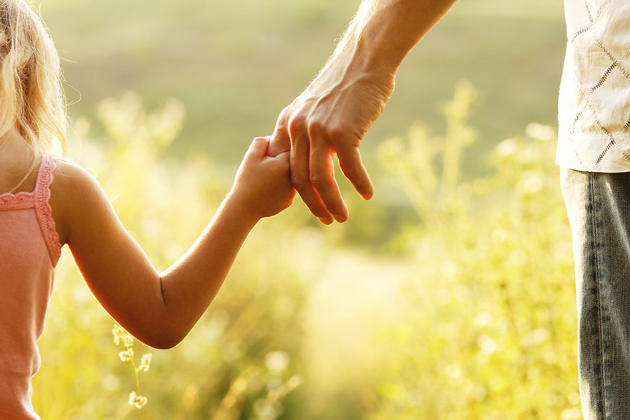 a parent holds the hand of a small child.jpg