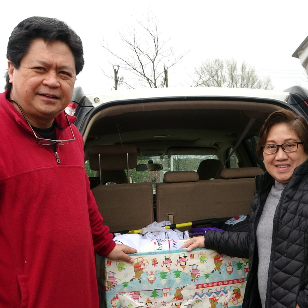 Dr. Linda Balugo receiving children's packages