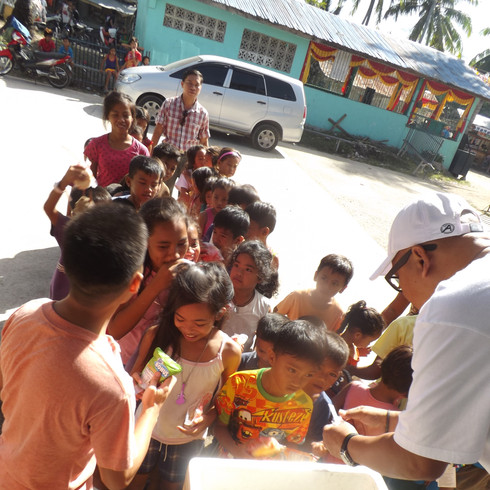 Children served food at the Mission