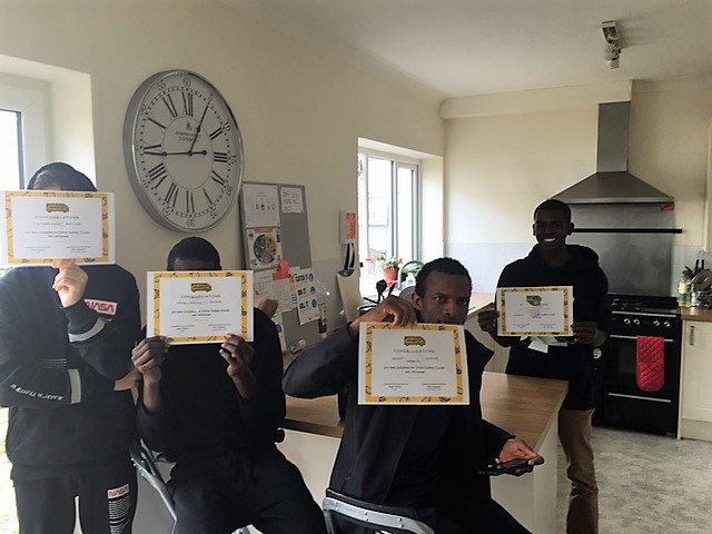 young people with their UK Harvest certificates