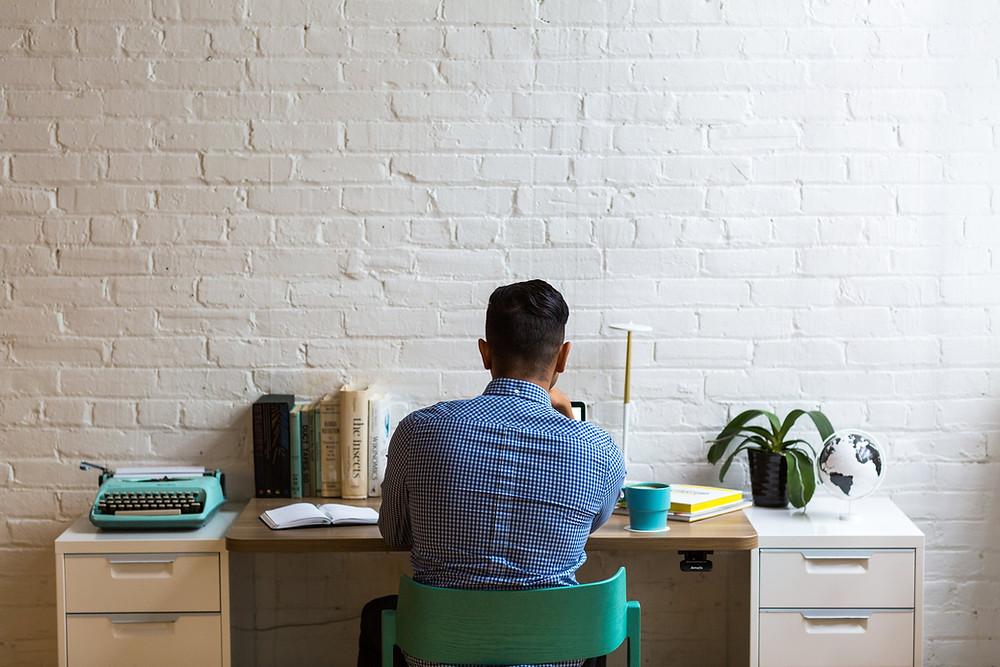 Man sat at a desk