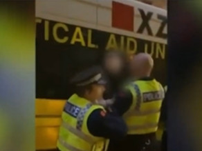 GMP Police grab student by the neck for shaking his head during protests