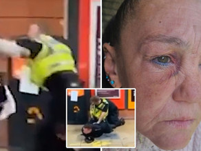 A grandmother has been left with a black eye after being 'punched to the ground by a police officer'